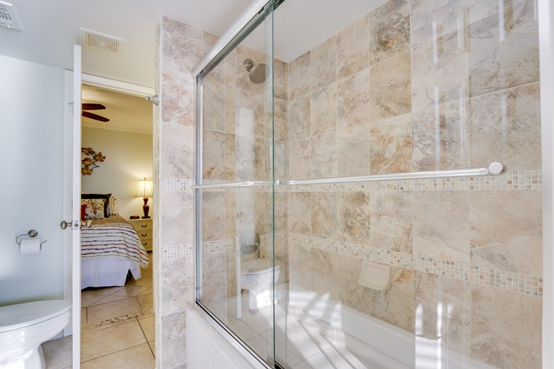 Beautifully tiled shower surround with glass doors