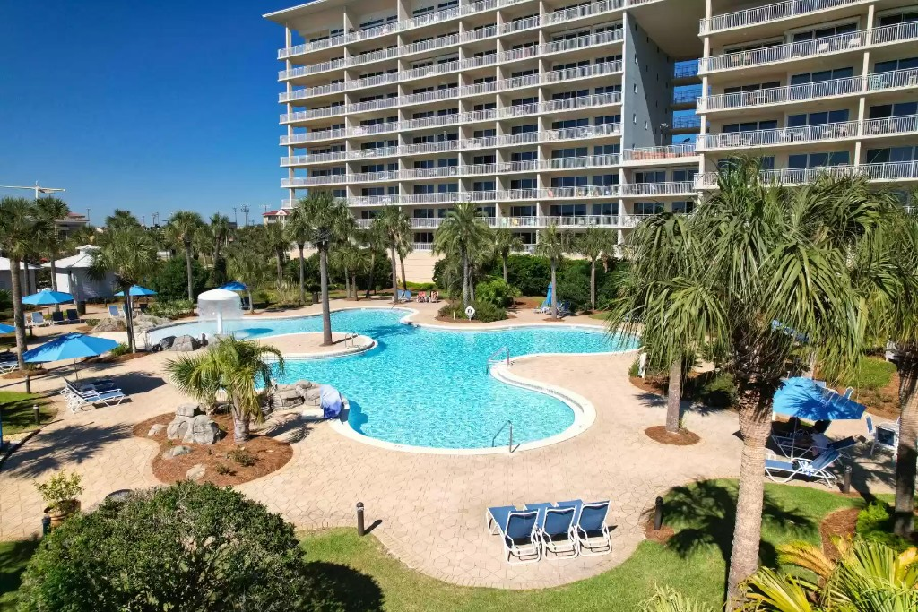Master suite with wide screen TV and reading space