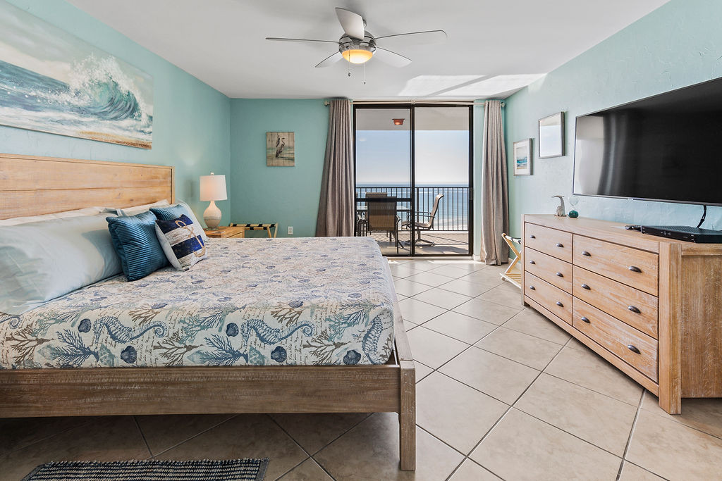 Master bedroom with king size bed and access to the balcony.