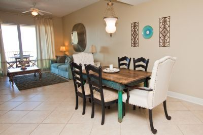 Large dining area with antique table and comfortable chairs