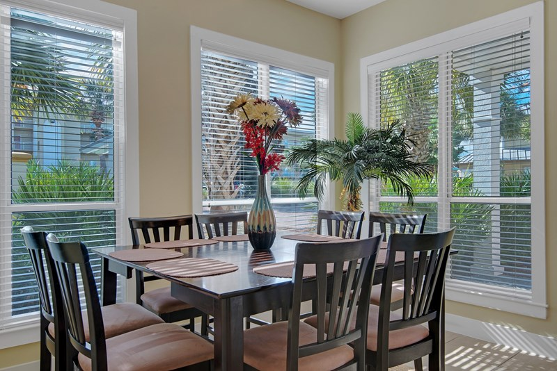 Dining area features a gathering table that accommodates 8!