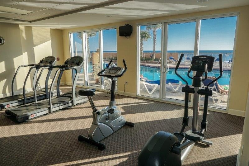 Fully equipped fitness center on the pool level