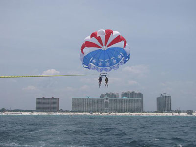 Our granddaughters parasailing with Majestic Sun in the background