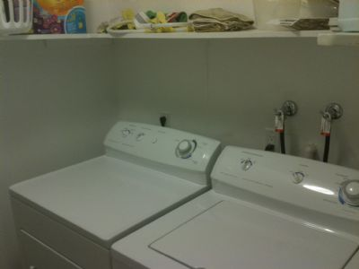 Full Size Washer and Dryer in Storage Room.