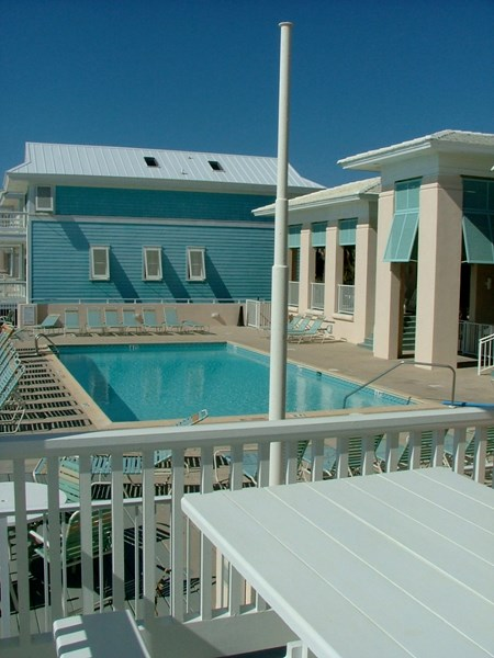 View of gulf front pool from living room deck. So close you can talk to your family from the deck!