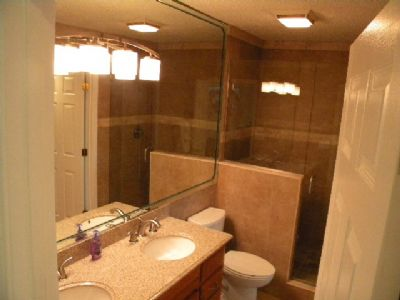 walk in tile shower/granite double sink