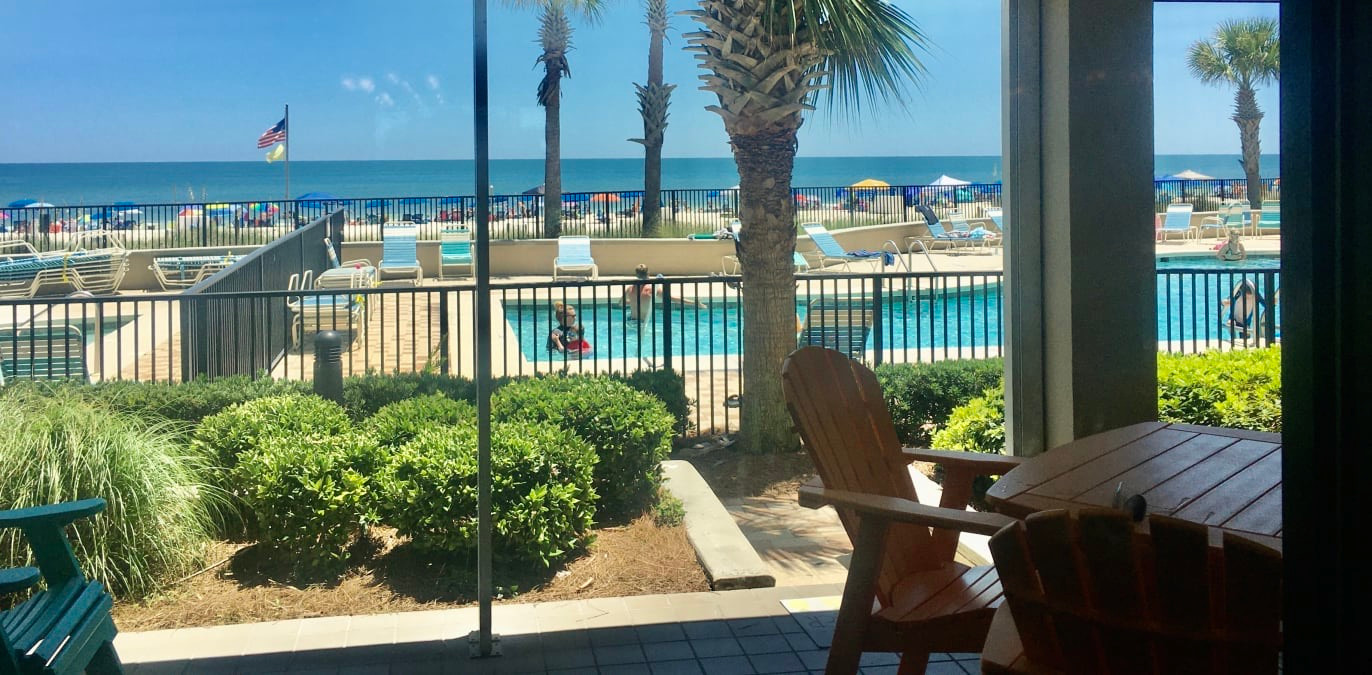 Ocean and Pool views!  Huge patio is shaded all day long!